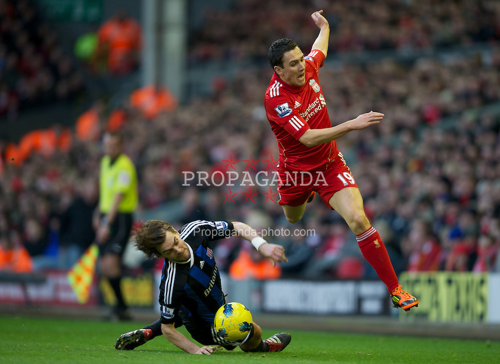 LIVERPOOL, ENGLAND - Saturday, January 14, 2012: Liverpool's Stewart Downing in action against Stoke City's Jonathan Woodgate during the Premiership match at Anfield. (Pic by David Rawcliffe/Propaganda)