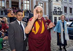 HUY, BELGIUM - MAY-30-2006 - The Dalai Lama greets children on the Grand Place of Huy before participating in a symposium with Belgium's top religious leaders.