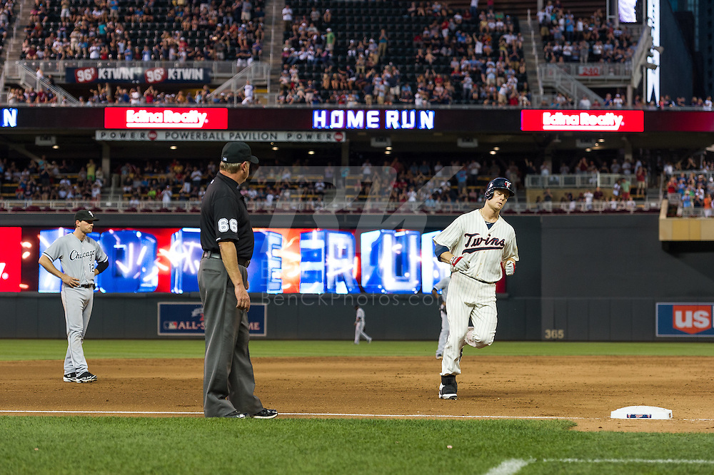 Justin Morneau #33 of the Minnesota Twins rounds the bases after hitting a home run against the Chicago White Sox on June 19, 2013 at Target Field in Minneapolis, Minnesota.  The Twins defeated the White Sox 7 to 4.  Photo: Ben Krause
