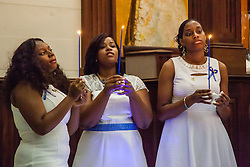 (L-R) Graduates Tamika Turnbull, Keturah Solomon, and Verissa Smith with candles.  Ten graduates of the University of the Virgin Islands School of Nursing commemorated their graduation with a pinning ceremony and lighting of candles while surrounded by nursing alumni, family, and friends.  University of the Virgin Islands School of Nursing 2015 Pinning Ceremony.  St. Thomas Reformed Church.  St. Thomas, VI.  12 May 2015.  © Aisha-Zakiya Boyd