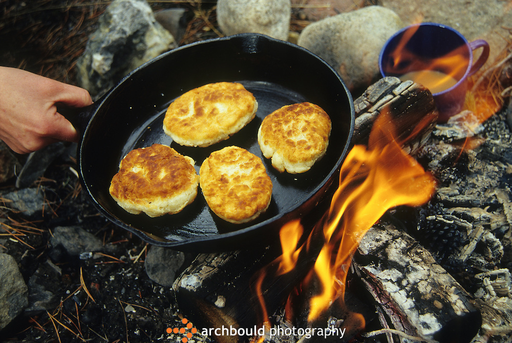 Cooking bannock over an open campfire