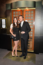 BEN & ELLE CARING at a private view of Made in Britain featuring contents from The Ivy sold to benefit Child Bereavement UK held at Sotheby's, 34-35 New Bond Street, London on 23rd March 2015.