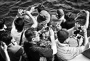 Tourists take photos of the Dokdo Islands, known to Japanese as Takeshima, sovereignty over which is disputed between Japan and South Korea, in the Sea of Japan on 22 June 2010..Photographer: Robert Gilhooly