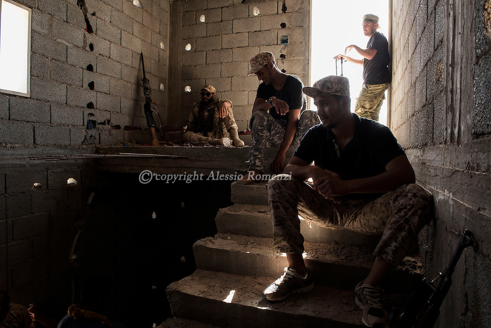 Libya: Fighters affiliated with Libya's Government of National Accord's (GNA) are seen inside a room on the frontline with ISIS in 700 neighbourhood in Sirte. Alessio Romenzi