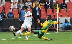 Ellis Park Johannesburg South Africa v Iraq (0-0) Confederations Cup 2009 14.06.2009 Younis Mahmoud  (Iraq)  Teko Modise (South Africa).