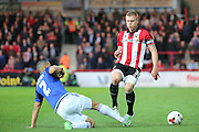 Cardiff City defender, Lee Peltier (2) tackling Brentford defender, Jake Bidwell (3) during the Sky Bet Championship match between Brentford and Cardiff City at Griffin Park, London, England on 19 April 2016. Photo by Matthew Redman.