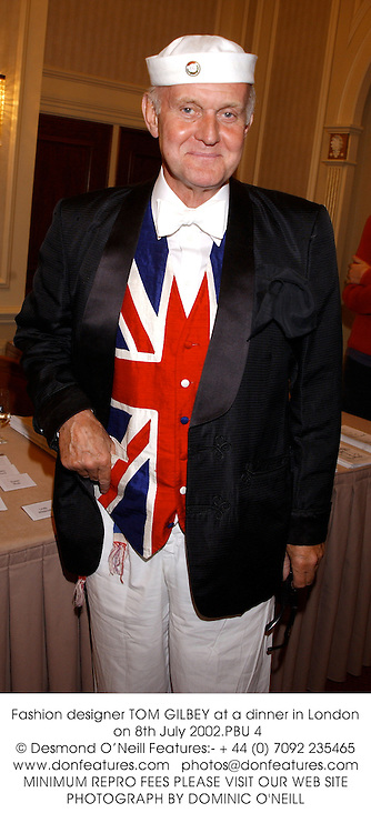 Fashion designer TOM GILBEY at a dinner in London on 8th July 2002.<br />