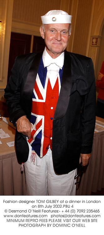Fashion designer TOM GILBEY at a dinner in London on 8th July 2002.<br />PBU 4