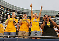 September 01 2012: Iowa fans cheer after a touchdown during the second half of the NCAA football game between the Iowa Hawkeyes and the Northern Illinois Huskies at Soldiers Field in Chicago, Illinois on Saturday September 1, 2012. Iowa defeated Northern Illinois 18-17.