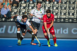 Belgium's Cedric Charlier is tackled by Lukas Windfeder of Germany. Belgium v Germany - Unibet EuroHockey Championships, Lee Valley Hockey & Tennis Centre, London, UK on 22 August 2015. Photo: Simon Parker