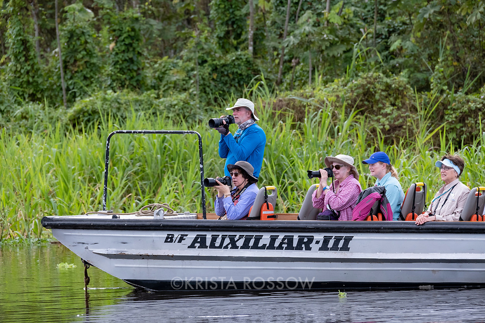 Photo Instructor Michael Nolan photographs with guests on a skiff excursion on the Yanayacu River in the Peruvian Amazon.