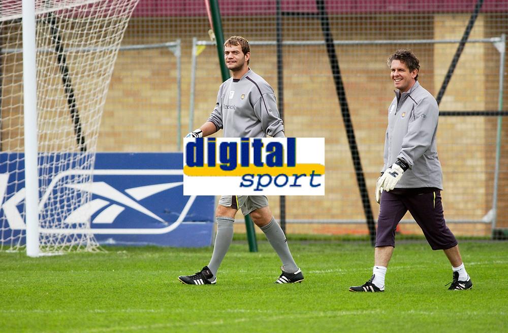 Photo: Daniel Hambury.<br />West Ham Utd Training. 03/11/2005.<br />Roy Carrol (L) and team physio Steve Allen walk to training.