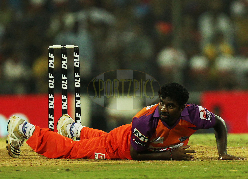 Muttiah Muralitharan of Kochi Tuskers Kerala falls down during  match 10 of the Indian Premier League ( IPL ) Season 4 between the Pune Warriors and the Kochi Tuskers Kerala held at the Dr DY Patil Sports Academy, Mumbai India on the 13th April 2011..Photo by BCCI/SPORTZPICS