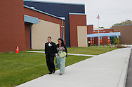 Seniors Collen Hicks (left) and Shavell Marshall head to the gym entrance for Belmont High School Prom at Belmont High School in Dayton, Saturday, April 28, 2012.