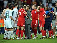 Fotball<br /> VM 2010<br /> England v Slovenia<br /> 23.06.2010<br /> Foto: Fotosports/Digitalsport<br /> NORWAY ONLY<br /> <br /> Fabio Capello Manager Congratulates Captain Steven Gerrard after the final whistle<br /> Slovenia V England 23/06/10 Group C at the Nelson Mandela Bay/Port Elizabeth Stadium FIFA World Cup 2010