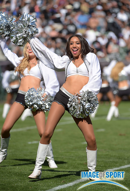 Sep 20, 2015; Oakland, CA, USA; Oakland Raiders raiderette cheerleaders perform during the game against the Baltimore Ravens at O.co Coliseum.