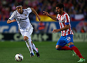 MADRID, SPAIN - APRIL 27: (R) Raul Garcia of Club Atletico de Madrid competes for the ball with (L) Sami Khedira of Real Madrid CF during the Liga BBVA between Club Atletico de Madrid and Real Madrid CF at the Vicente Calderon stadium on April 27, 2013 in Madrid, Spain. (Photo by Aitor Alcalde Colomer).