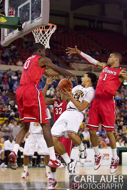 November 27th, 2010:  Anchorage, Alaska - Arizona State's Trent Lockett (24) slices through the Red Storm defense for a shot attempt in the Sun Devil's 58-67 loss to St. Johns in the championship game of the Great Alaska Shootout.