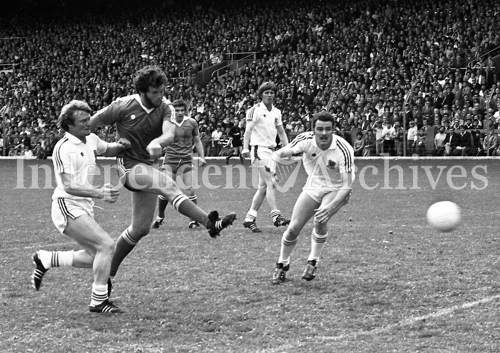 881-292<br /> 1981 Championship<br /> Game 3. All-Ireland Semi-Final<br /> Kerry V Mayo in Croke Park on August 9th, 1981<br /> Final Score: Kerry 2-19 Mayo 1-6.<br /> Eoin Liston kicks Kerry's 2nd goal into the Cork net at Croke Park, 9/8/81.<br /> (Part of the Independent Newspapers Ireland/NLI Collection)
