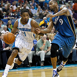 February 1, 2011; New Orleans, LA, USA; New Orleans Hornets small forward Trevor Ariza (1) drives past Washington Wizards power forward Rashard Lewis (9) during the first quarter at the New Orleans Arena.   Mandatory Credit: Derick E. Hingle