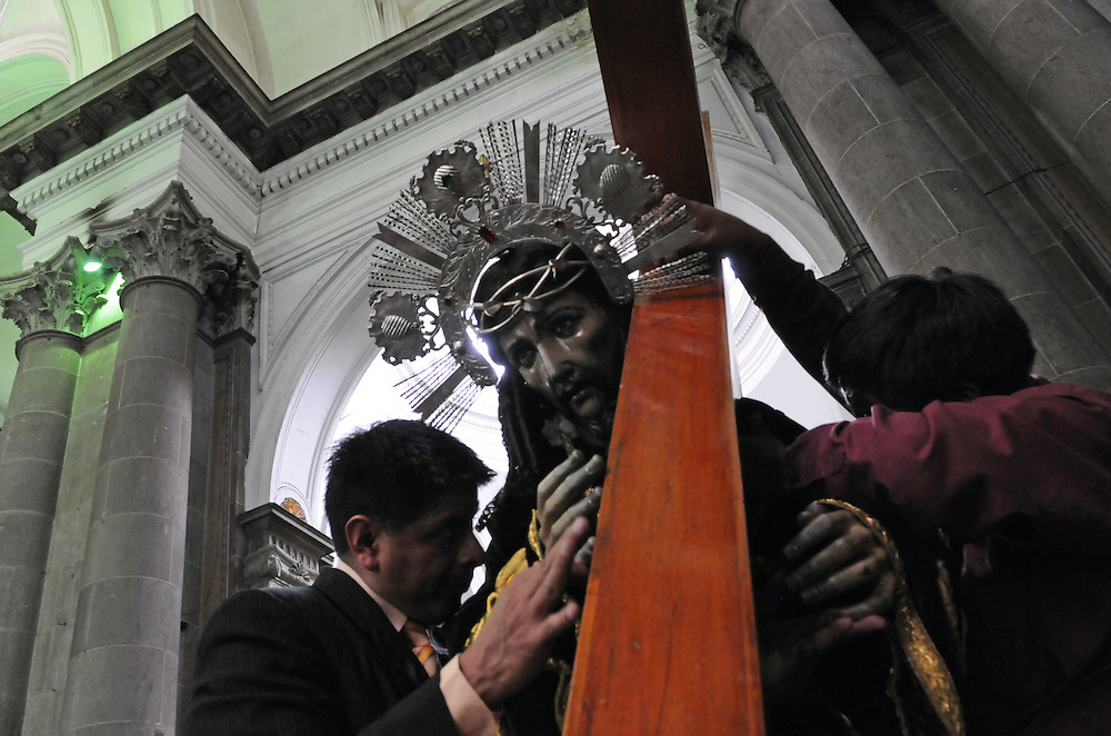 Apr 21, 2011 - Quetzaltenago, Guatemala - Before starting the Procession of the Just Judge two members of the Nazarene brotherhood place a large wooden cross on the shoulders of the statue of Jesus of Nazareth..(Credit Image: © Josh Bachman/ZUMA Press)