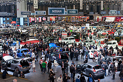 Interior view of crowds of visitors at the Geneva Motor Show 2011 Switzerland