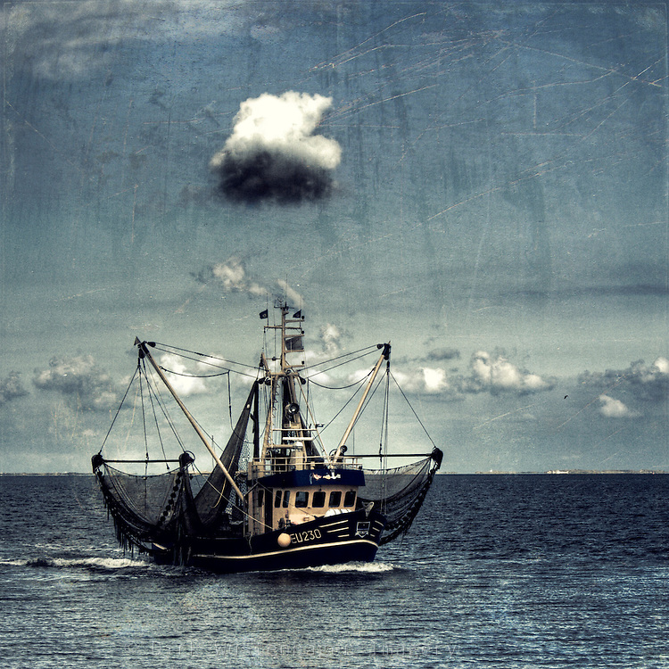 Cutter returning home from sea. Texturized and manipulated photograph.<br />