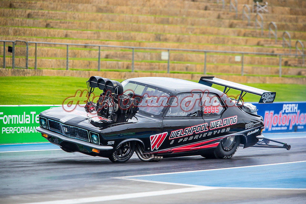 Russell Taylor getting out of shape in the burnout.. Shot at the Aeroflow Nitro Hot Rods round at Perth Motorplex - © Phil Luyer - High Octane Photos
