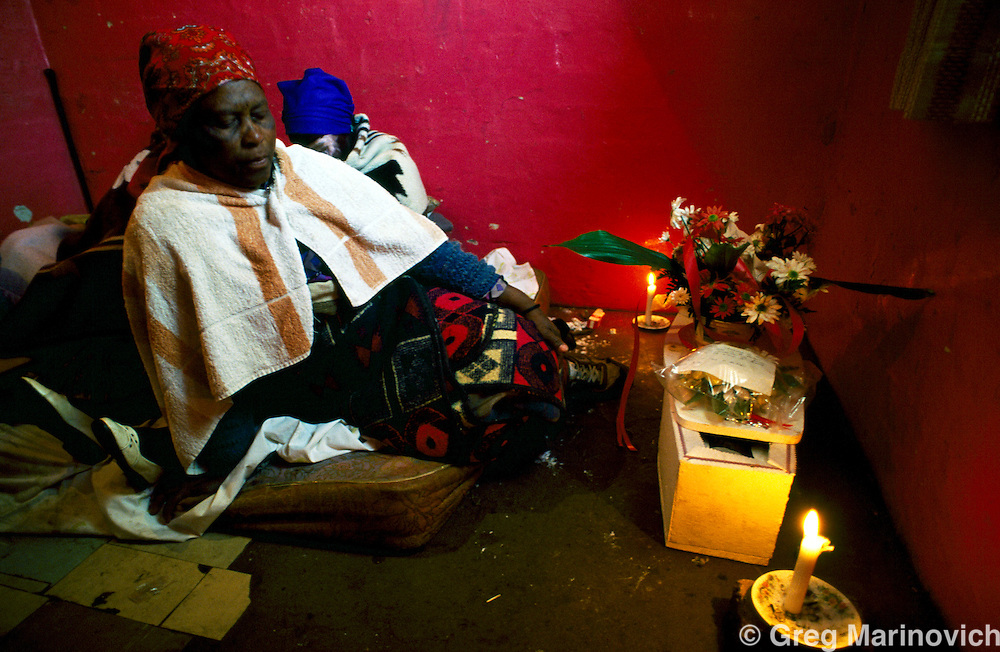 Boipatong, Vaal, South Africa, June 1992. The aunt of slain infant Aaron mathope sits a vigil ahead of the funeral of 41 men women and children killed by IFP supporters in Boipatong, June 1992.