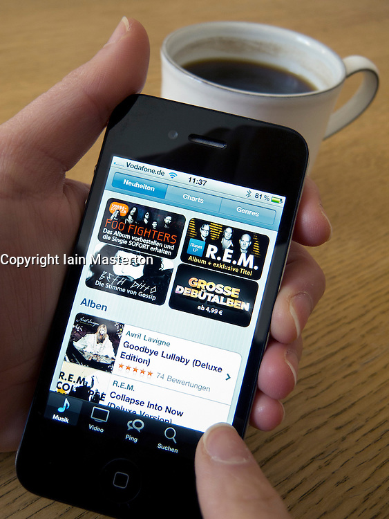Browsing iTunes digital music store on an Apple iphone 4G smart phone