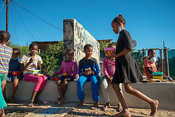 Kids eat at a volunteer food drive in Mountain View, an informal settlement in Jamestown, located in the Cape Winelands District, on Saturday, May 29, 2020. It's estimated that most, if not all, of the households here had no income, due to unemployement during lockdown. Cape Winelands is one of the districts in the Western Cape that has been designated a hotspot area, in terms of people testing positive for COVID-19. When South Africa moves down to Stage 3 of the nationwide lockdown on June 1st, hotspots areas will remain under stricter regulation and surveillance, per the latest government announcements. PHOTO: EVA-LOTTA JANSSON