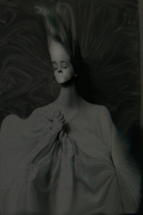A distorted image of a young woman