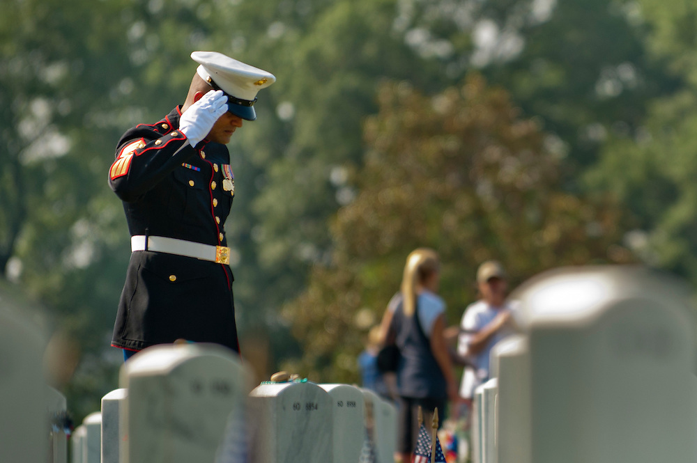 Marine SSgt. KERRY LALCHAN salutes the grave of his friend Marine Lance Cpl. Dennis James Burrow on Memorial Day in Section 60 of Arlington National Cemetery.