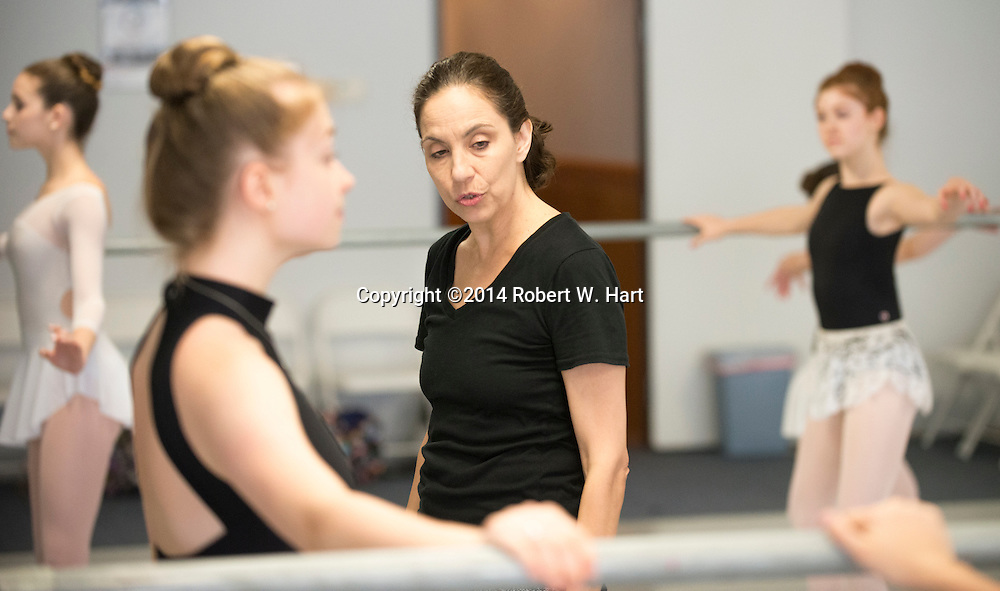 Dancers at Mejia Ballet in Arlington, Texas are coached by Maria Terezia Balogh on August 18, 2014.