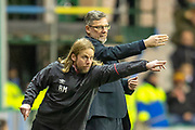 Craig Levein, manager of Heart of Midlothian and Austin MacPhee, assistant manager of Heart of Midlothian (front) point the way during the Ladbrokes Scottish Premiership match between Hibernian FC and Heart of Midlothian FC at Easter Road Stadium, Edinburgh, Scotland on 29 December 2018.