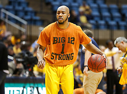 Jan 20, 2018; Morgantown, WV, USA; West Virginia Mountaineers guard Jevon Carter (2) wears a warm up shirt in honor of Andrew Jones, the Texas point guard who was recently diagnosed with leukemia prior to their game against the Texas Longhorns at WVU Coliseum. Mandatory Credit: Ben Queen-USA TODAY Sports