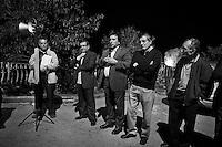 Torretta, Italy, 17 October 2012: Nino Dina (center), a candidate for the Sicilian Regional Assembly, gives a speech in a restaurant during a sausage and pizza night organized by his supporters in Torretta, Italy, on 17 October 2012. Nino Dina, a 55 years representative of the Sicilian Regional Assembly (ARS) running for the fourth time since 2001, was under investigation for Mafia ties in 2008. The case was archived in 2010.<br /> <br /> <br /> The direct elections in Sicily for the President of the Region and its representatives will take place on Sunday 28 October 2012, 6 months ahead of the end of the terms of office of the current legislature. The anticipated election of October 28 take place after Raffaele Lombardo, former governor of Sicily since 2008, resigned on July 31st. Raffaele Lombardo is under investigation since 2010 for Mafia ties. His son Toti Lombardo is currently running for a seat in the Sicilian Regional Assembly in the coalition of Gianfranco Micciché, a candidate for the Presidency of the Region. 32 candidates belonging to 8 of the 20 parties running for the Sicilian elections are either under investigation or condemned. ### Torretta, Italia, 17 ottobre 2012: Nino Dina (al centro), un candidato per l'Assemblea Regional Siciliana con l'UdC (Unione di Centro), fa un comizio in un ristorante durante una mangiata di salsiccia e pizza organizzata dai suoi sostenitori a Torretta, Italia, il 17 ottobre 2012.  Nino Dina, un deputato di 55 anni dell'Assemblea Regionale Siciliana (ARS) candidato per la quarta volta dal 2001, è stato indagato per concorso esterno in associazione mafiosa nel 2008. Il suo fascicolo è stato archiviato nel 2010.<br /> <br /> Le elezioni in Sicilia per la votazione diretta del presidente della regionee dei deputati all'Assemblea regionale (ARS)si terranno domenica 28 ottobre, in anticipo sulla scadenza naturale dell'attuale legislatura, prevista ad aprile dell'anno prossimo. In Sicilia si vota in anticipo dopo le dimissionid