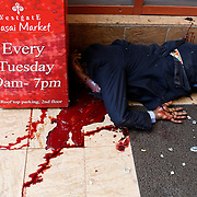 A dead man lies at the entrance of the Westgate Shopping Centre.