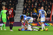 Abdelhamid Sabiri (29) of Huddersfield Town down injured during the Premier League match between Bournemouth and Huddersfield Town at the Vitality Stadium, Bournemouth, England on 4 December 2018.