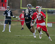 Connor Hulme of Canandaigua breaks past Jared Conners of Pittsford during a game in Canandaigua on Saturday, April 11, 2015.