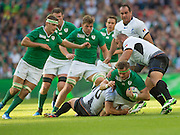 Wembley, Great Britain,  Jamie HEASLIP, tackled,  during the Pool D Game, Ireland vs Romania.  2015 Rugby World Cup, Venue, Wembley Stadium, London, ENGLAND.  Sunday  27/09/2015 <br /> <br /> Mandatory Credit; Peter Spurrier/Intersport-images]