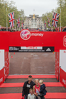 Great Britain's Paula Radcliffe with her family after crossing the line on The Mall to complete her final marathon at the Virgin Money  London Marathon, Sunday 26th April 2015.<br /> <br /> Dillon Bryden for Virgin Money London Marathon<br /> <br /> For more information please contact Penny Dain at pennyd@london-marathon.co.uk
