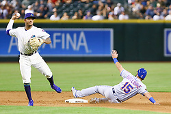 June 14, 2018 - Phoenix, AZ, U.S. - PHOENIX, AZ - JUNE 14: Arizona Diamondbacks shortstop Ketel Marte (4) turns the double play during the MLB baseball game between the Arizona Diamondbacks and the New York Mets on June 14, 2018 at Chase Field in Phoenix, AZ (Photo by Adam Bow/Icon Sportswire) (Credit Image: © Adam Bow/Icon SMI via ZUMA Press)