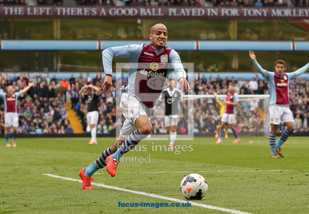 Karim El Ahmadi of Aston Villa chases the ball during the Barclays Premier League match at Villa Park, Birmingham<br /> Picture by Tom Smith/Focus Images Ltd 07545141164<br /> 19/04/2014