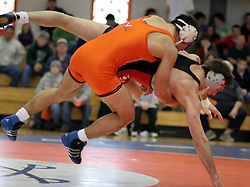 Mike Sewell takes down Ohio State's Steve Sommer in a dual meet in Charlottesville.  Sewell lost the match, 6-3, and UVA fell to the Buckeyes 28-10.