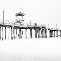 Huntington Beach Pier panorama photo in black and white. Huntington Pier is in Surf City USA in Orange County Southern California