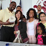 """Inductee Thomas """"Hitman"""" Hearns poses with family members during the 23rd Annual International Boxing Hall of Fame Induction ceremony at the International Boxing Hall of Fame on Sunday, June 10, 2012 in Canastota, NY. (AP Photo/Alex Menendez)"""
