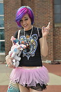 Garden City, New York, U.S. - June 14, 2014 - A girl with colorful hair and wearing a pink and black tutu is, in her own words, Generic Pixie #3, at Eternal Con, the annual Pop Culture Expo, with costumes, Comic Books, Collectibles, Gaming, Sci-Fi, Cosplay, horror, and held at the Cradle of Aviation Museum on Long Island.