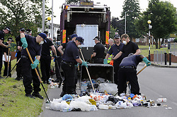 © Licensed to London News Pictures. 09/08/2012 .Police search teams still working hard at 5pm, searching rubbish bins on the Fieldway Estate opposite the Fieldway Community Centre in New Addington. Sixth day (09.08.2012) Tia Sharp has been missing..  12 years old Tia Sharp has been missing from the Lindens on The Fieldway Estate in New Addington,Croydon,Surrey since Friday last week. .Photo credit : Grant Falvey/LNP