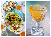 Diptych showing a table with platters of summer foods set out on a dimpled glass table.  A close up of a cup emptied of its cold carrot soup resting on the table.